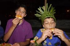 Nathan and Aidan eat their Zanzibar pizza.