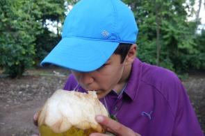 Nathan samples coconut water.