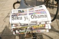 "The headline translates to ""Day of Obama."""