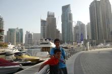 Aidan and Nathan are melting on our walk around Dubai Marina.