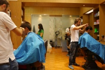 Some people shop at Dubai Mall for Chanel. We... get our hair cut. The boys were due.