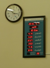 Board shows prayer times for the day, based on the lunar calendar.