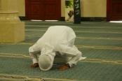 Muslim man demonstrates prayer.
