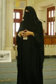 Guide demonstrating the burka.