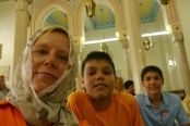 Shellie, Aidan, and Nathan waiting for start of mosque tour.
