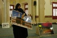 Guide discussing Muslims' pilgrimage to Meeca.