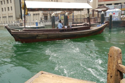 We took a boat like this called an abra across the Creek.