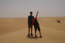 Boys baking in the desert