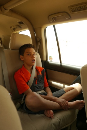 Aidan in the back seat, enjoying the air conditioning