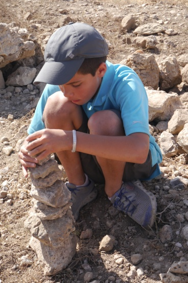 Aidan keeps himself busy in the hot sun, waiting for the flat tire fix.