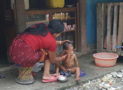 Little boy getting his bath