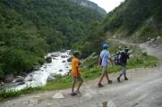 Aidan, Nathan, and Santos hiking along the Seti River.
