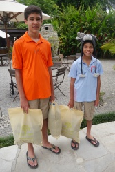 Nathan and Aidan are holding the bags that we're bringing to the orphanage. Aidan had picked out this hat to wear on the trek. We thought it looked like a yak.