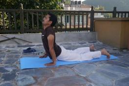 Yoga instructor demonstrating the Cobra position.