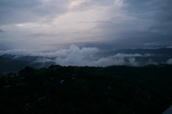 Behind those clouds is the Annapurna Range of the Himalayas. The sun is just about to rise.