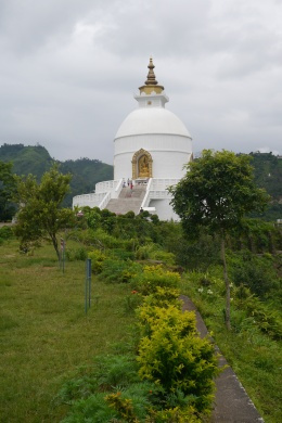This is one of 71 peace pagodas built around the world by a Japanese Buddhist group. It sits on a hill overlooking Pokhara.