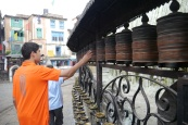 Boys spin Buddhist prayer wheels