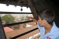 From top of palace, Aidan points to Monkey Temple in the distance.
