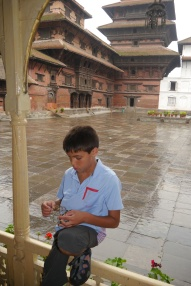 Aidan is more focused on his new toy that he bought from a street vendor than the guide's lecture.