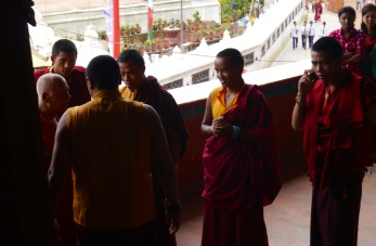 Even monks need to make cell phone calls.