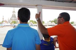 Nathan, Aidan, and Neerav take in sites along Chao Phraya River.