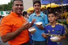 Neerav, Nathan, and Aidan enjoying a cool coconut treat.