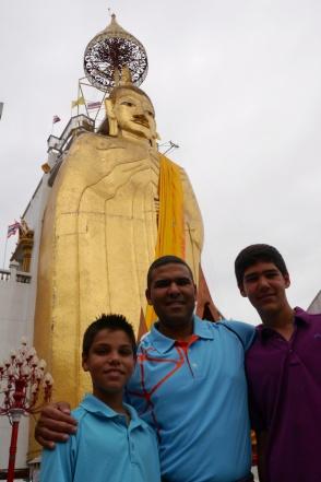 Aidan, Neerav, and Nathan with Standing Buddha