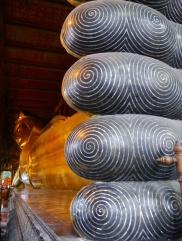 The Reclining Buddha measures 150-feet long. The spirals on the toes are made from Mother of Pearl.