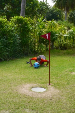 """Aidan is sizing up his """"putt."""""""