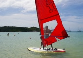 Neerav attempts to windsurf for the first time.