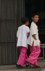 Boys in theirl uniforms being dismissed from school