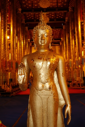 Standing Buddha with hand in this position references not fighting with your relatives.