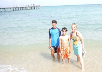 Nathan, Aidan, and Shellie enjoy the sun and surf