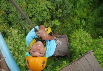 Reluctant Aidan starts his abseil - 131 feet down.