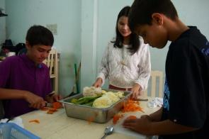 Neerav and Shellie like watching the kids do the work!