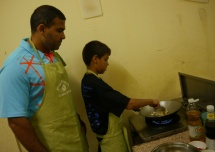 Neerav supervised Aidan as he cooks cashews.