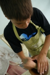 Aidan likes pounding and grinding ingredients. Big surprise.