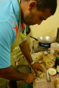Neerav chopping tofu for Pad Thai.