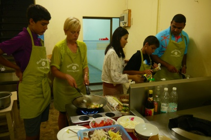 Bailey-Shah family working together in the kitchen
