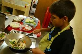 Aidan getting wok cooking down
