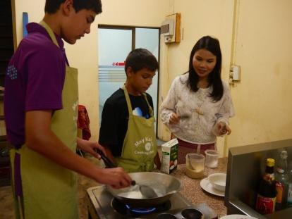 The boys start the desserts: Potato Pudding and Mango Sticky Rice.