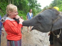 Shellie gets a hug from the baby elephant.