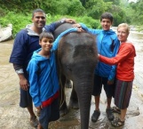Family photo with baby elephant
