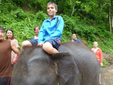 Aidan rides baby solo back to camp.