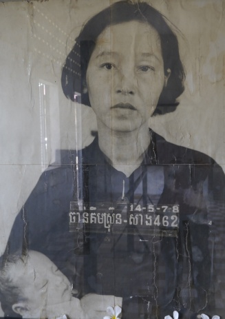This woman's husband worked for the government; he was killed. Then her baby was murdered in front of her, before the Khmer Rouge killed her.