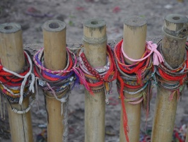 Visitors leave bracelets in memory of the victims.