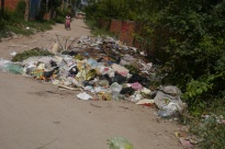 While not as prevalent as in Africa, trash does line some of the streets in Phnom Penh. No one bags trash here. Garbage trucks come along, and using pitch forks, workers throw the rubbish into the back.