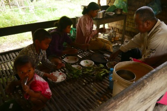 The family enjoys the fish paste/red ant lunch.