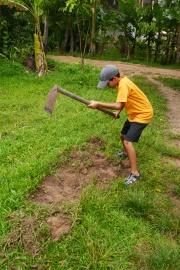 Aidan swings the hoe. Watch out!