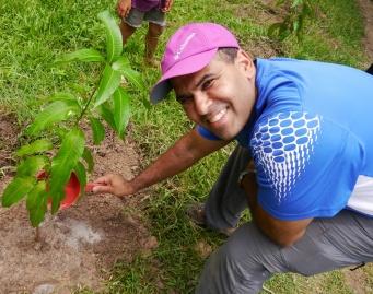Neerav waters his tree.